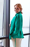 Young beautiful woman in green jacket Stock Photography