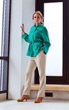 Young beautiful woman in green jacket Royalty Free Stock Images