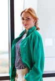 Young beautiful woman in green jacket Stock Photos