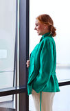 Young beautiful woman in green jacket Stock Images