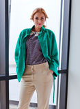 Young beautiful woman in green jacket Royalty Free Stock Photography