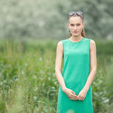 Young beautiful woman on the green meadow art portrait Stock Photos