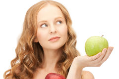 Young beautiful woman with green and red apples Royalty Free Stock Image
