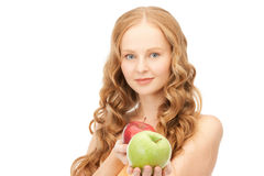 Young beautiful woman with green and red apples Royalty Free Stock Images