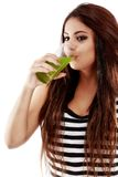 Young beautiful  woman with green soda and drinking Royalty Free Stock Photo