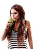 Young beautiful  woman with green soda and drinking Royalty Free Stock Photos