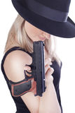 Young beautiful woman with a gun Stock Photography