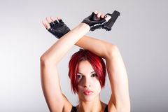 Young beautiful woman with a gun. Portrait of young beautiful woman with a gun stock images