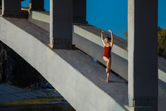 Young beautiful woman gymnast posing on bridge girder Stock Image