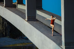 Young beautiful woman gymnast posing on bridge girder Royalty Free Stock Photography