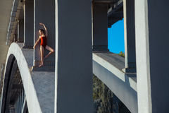 Young beautiful woman gymnast posing on bridge girder Stock Photography