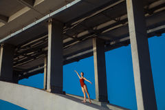 Young beautiful woman gymnast posing on bridge girder Royalty Free Stock Photo