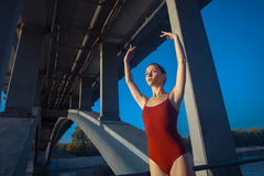 Young beautiful woman gymnast posing on bridge girder Royalty Free Stock Image