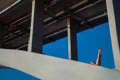Young beautiful woman gymnast posing on bridge girder Royalty Free Stock Photos