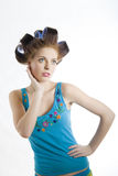 Young beautiful woman in hair curlers Stock Photography