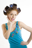 Young beautiful woman in hair curlers Stock Image