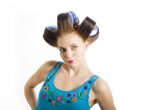 Young beautiful woman in hair curlers Royalty Free Stock Photo