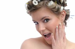 Young beautiful woman with hair rollers - surprise Royalty Free Stock Images