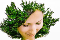 Young beautiful woman with the hairstyle on the head as a tree Stock Photo