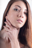 Young Beautiful Woman hand on neck headshot Royalty Free Stock Photography