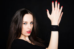 Portrait of beautiful brunette with hands tied Stock Images