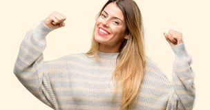Young beautiful woman isolated over yellow background royalty free stock photo