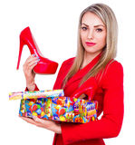 Young beautiful woman happy to receive red high heels shoes as a present royalty free stock photos