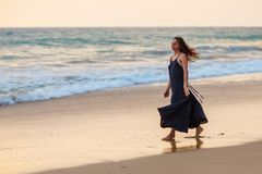 Young beautiful woman has fun at the ocean in summertime Royalty Free Stock Images