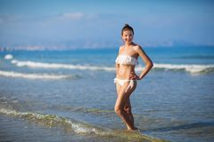 Young beautiful woman has fun at the sea in summertime Stock Photography