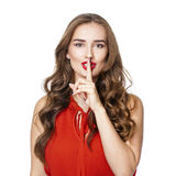 Young beautiful woman has put forefinger to lips as sign of sile Royalty Free Stock Photo