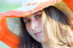 Young beautiful woman with hat Stock Photos