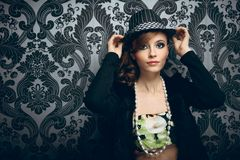 Young beautiful woman in hat Stock Image