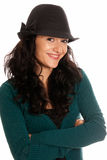 Young beautiful woman with hat arms crossed. Isolated on white background Stock Photos