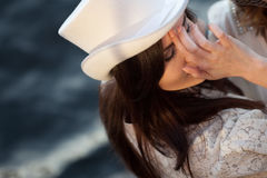 Young beautiful woman in hat, cylinder, outdoors, close-up Royalty Free Stock Photos