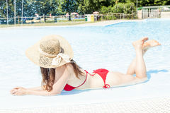 Young beautiful woman with hat relaxes in the hydromassage Stock Images