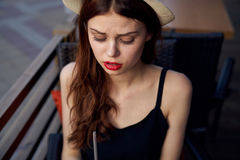 Young beautiful woman in a hat on the street, portrait.  Stock Images