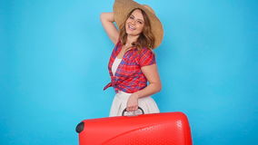 Young beautiful woman in hat with suitcase. Young beautiful woman with suitcase. Travel concept stock video footage