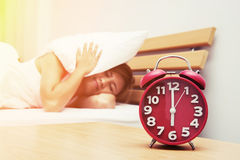 Young beautiful woman hates waking up early in the morning. Slee Royalty Free Stock Images