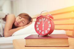 Young beautiful woman hates waking up early in the morning. Slee Royalty Free Stock Photography