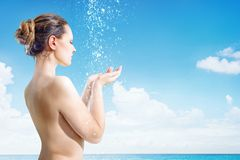 Young woman have shower on the tropical beach stock photos