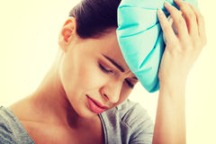 Young beautiful woman is haveng a headache. Royalty Free Stock Photos