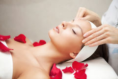 Young Beautiful Woman Having Facial Massage Stock Photos
