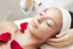 Young Beautiful Woman Having Facial Massage Royalty Free Stock Photo