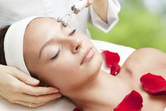 Young Beautiful Woman Having Facial Massage Royalty Free Stock Photography