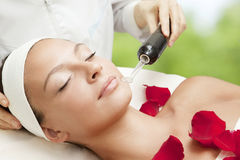 Young Beautiful Woman Having Facial Massage Stock Photo