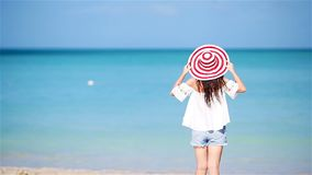 Young beautiful woman having fun on tropical seashore. Happy girl running at white sand tropical beach. Young happy woman in swimsuit on white beach stock footage