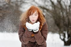 Young beautiful woman having fun in winter Royalty Free Stock Photos