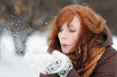 Young beautiful woman having fun in winter Stock Photos