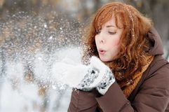 Young beautiful woman having fun in winter Stock Photos