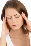 Young beautiful woman having a headache Stock Photos
